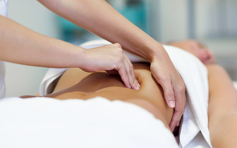 back of woman massaged