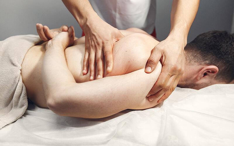 mans shoulder being massaged